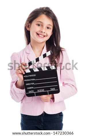Beautiful young girl, smiling to camera while holding a movie makers clapperboard. Isolated on studio white background. - stock photo