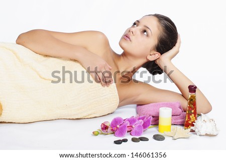 beautiful young girl spa on white background