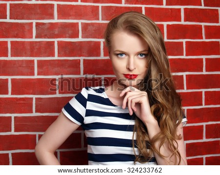 Beautiful young girl striped dress