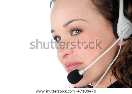 beautiful young girl talking on the phone with a client through the headphones