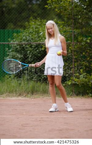 beautiful young girl tennis player - stock photo