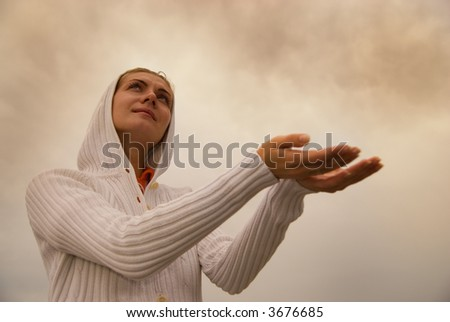 Beautiful young girl waiting for the rain at stormy day - stock photo