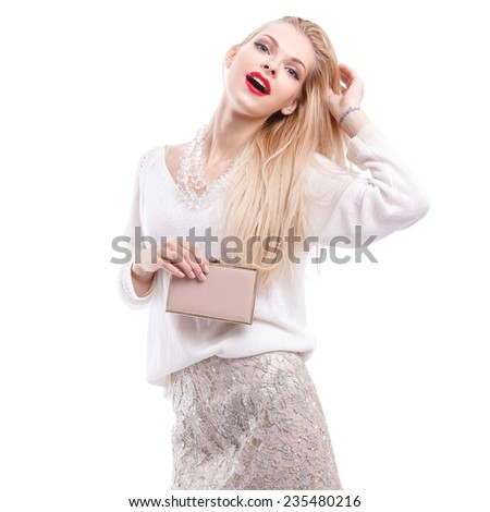 Beautiful young girl with a bright evening make up of shiny red lipstick holding a clutch. Fashion Celebration, sale, happiness
