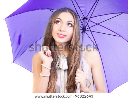 beautiful young girl with a bright umbrella, isolated in white, studio shot