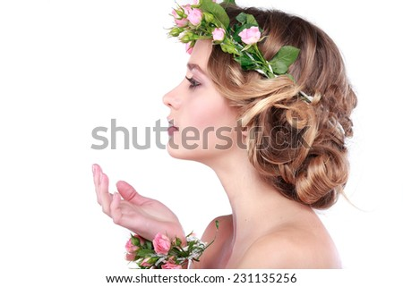 Beautiful young girl with a chaplet from roses   in hairs, emotions, cosmetics, isolated on a white  background  - stock photo