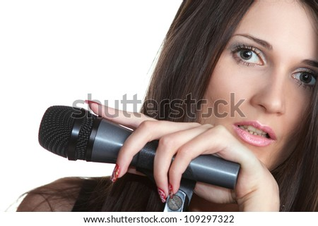 beautiful young girl with a microphone - stock photo