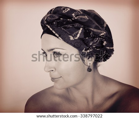 Beautiful young girl with a scarf on the head, make-up, black and white photo