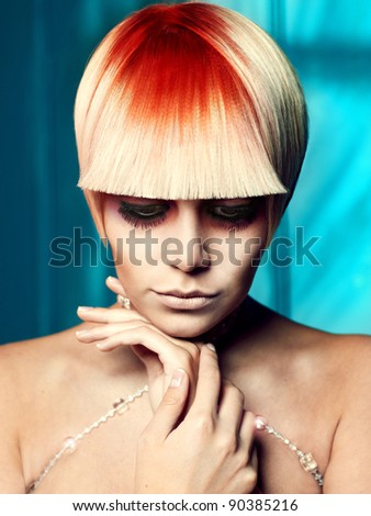 Beautiful young girl with a white-red hair and fancy make-up - stock photo