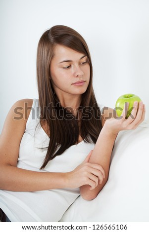 Beautiful young girl with apple