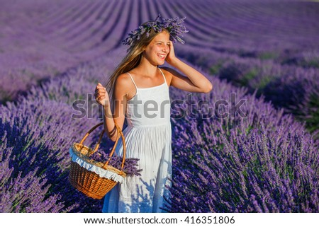 Beautiful young girl with basket in the lavander fields in Valensole. Provence, France. - stock photo