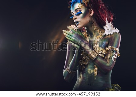 Beautiful young girl with body art in an unusual fantasy style