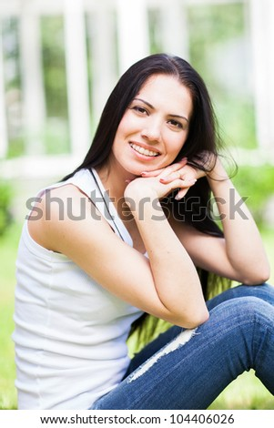 Beautiful young girl with braces on her teeth - stock photo