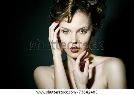 Beautiful young girl with bright makeup - stock photo