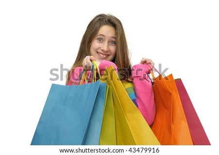 Beautiful young girl with colorful bags isolated in white