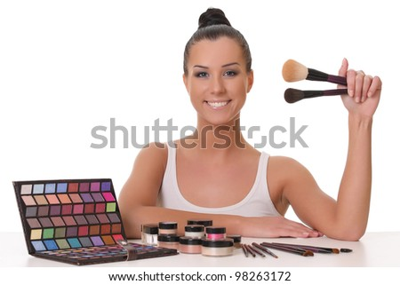 beautiful young girl with cosmetics - stock photo