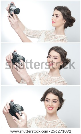 Beautiful young girl with creative make-up and hair style taking photos of herself with a camera. Fashionable attractive teenage girl taking a self portrait. Selfie, indoor, horizontal, over white.