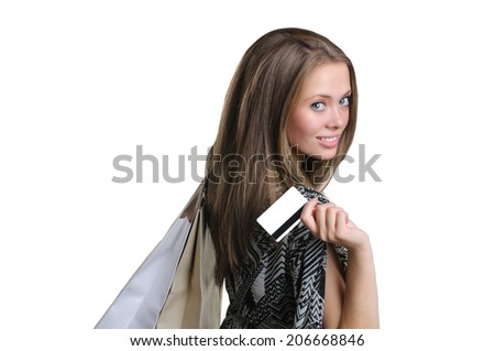 Beautiful young girl with credit card and shopping bag - stock photo