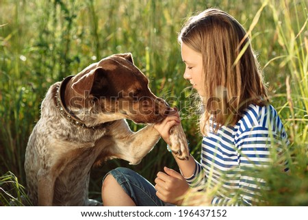 beautiful young girl with dog - stock photo