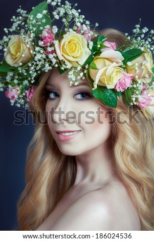 Beautiful young girl with hairstyle and flowers in her hair