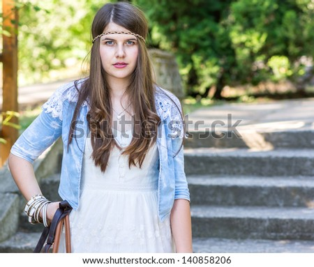 beautiful young girl with handbag