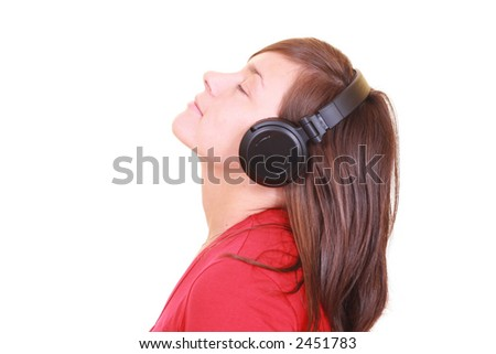 beautiful young girl with headphones isolated on white - stock photo