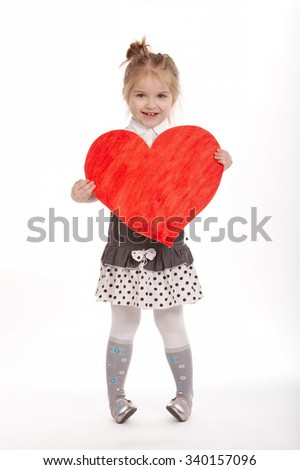beautiful young girl with heart on white