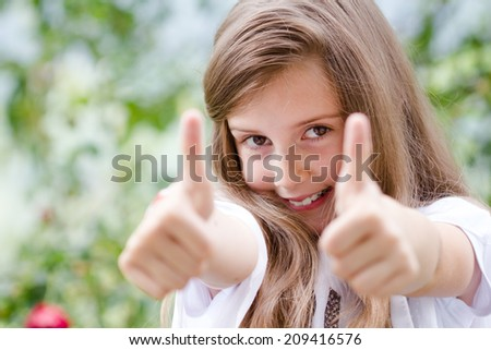 beautiful young girl with long hair saying ok and pointing with her fingers - stock photo