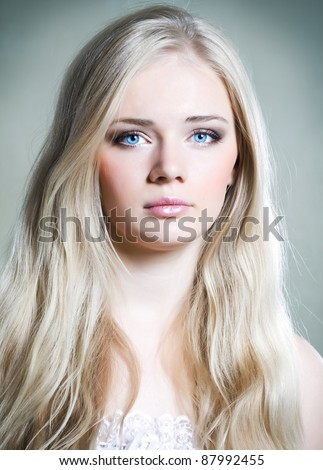 Beautiful young girl with long white hair and shiny skin - stock photo