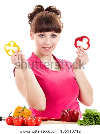 Beautiful young girl with pepper on white background. - stock photo