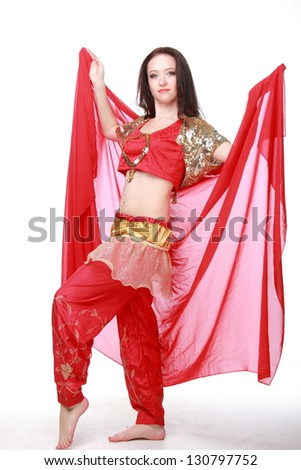 Beautiful young girl with perfect figure in eastern dress