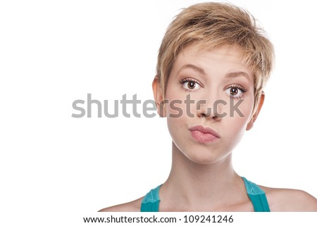 Beautiful young girl with short hair on a white background