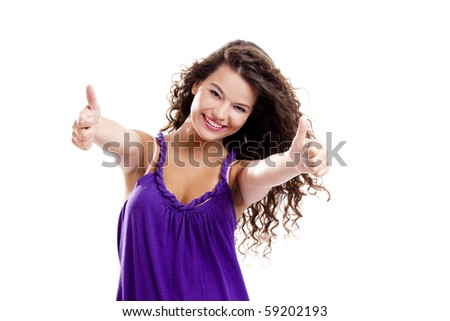 Beautiful young girl with thumbs up isolated on white - stock photo