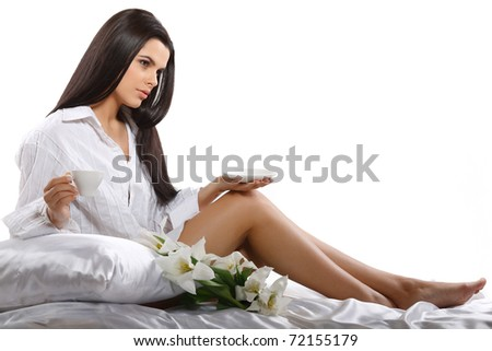beautiful young girl with tulips and with the cup of coffee - stock photo