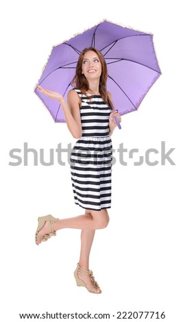 Beautiful young girl with umbrella isolated on white - stock photo