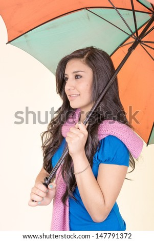 beautiful young girl with umbrella,  studio shot