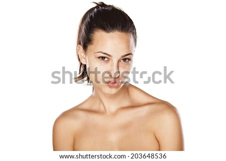 beautiful young girl without make up and pursed lips - stock photo