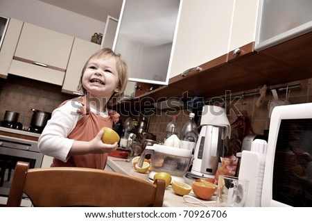 Beautiful young Girl Working in the Kitchen - stock photo
