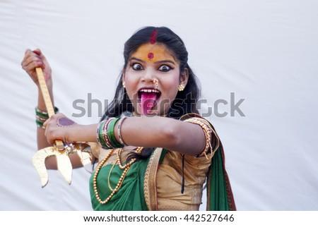 Beautiful young girls dressed as hindu goddes Durga. - stock photo