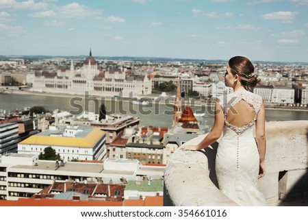 Beautiful young happy bride in a white dress on the street in Budapest, Hungary
