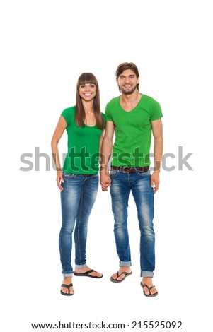 beautiful young happy couple love smiling embracing, man and woman smile looking at camera wear green shirt jeans, isolated over white background
