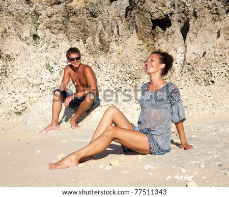 Beautiful young happy couple on vacation near the ocean - stock photo