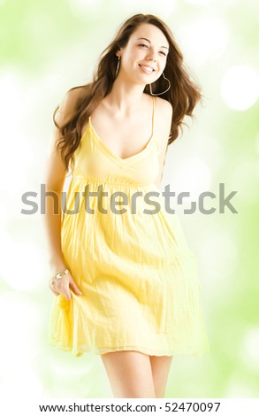Beautiful young happy girl in yellow dress - stock photo