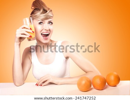 Beautiful young happy woman drinking orange juice, smiling. Healthy lifestyle. - stock photo