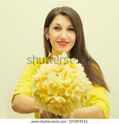 beautiful young happy woman gives bouquet of flowers - stock photo