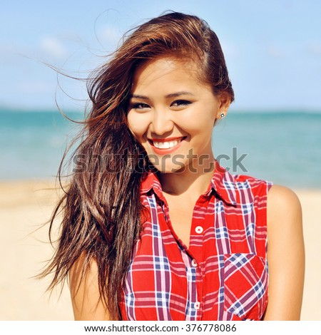 Beautiful young happy woman smiling close up - stock photo