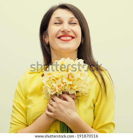 beautiful young happy woman with flowers - stock photo