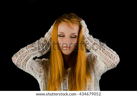 Beautiful young happy woman with long flowing red hair     - stock photo