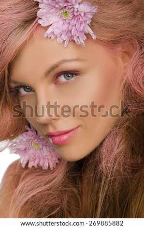 Beautiful young happy woman with pink hair and flowers - stock photo