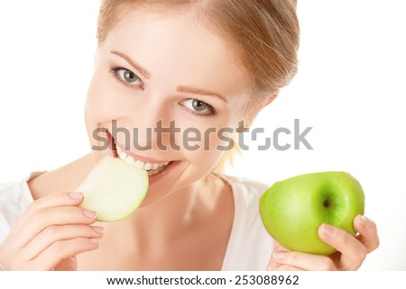 beautiful young healthy girl eating an apple on a white background - stock photo