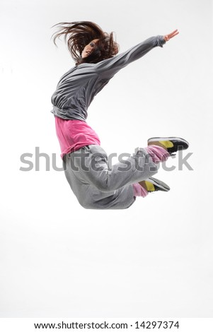beautiful young hip-hop dancer posing on white background